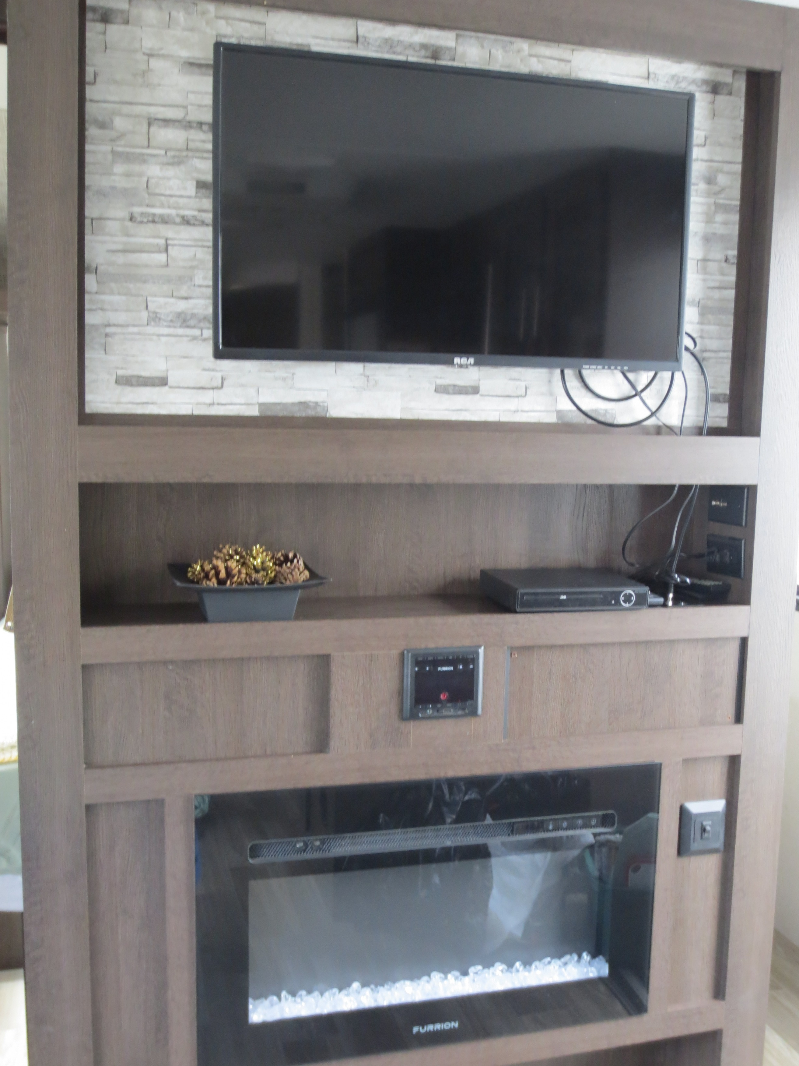 29' Cruise Lite Trailer with Slide-out TV Fireplace View