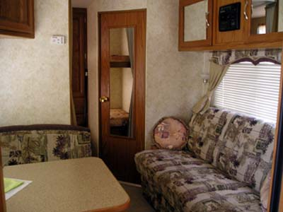 27' Topaz Trailer Interior View with dinette & couch