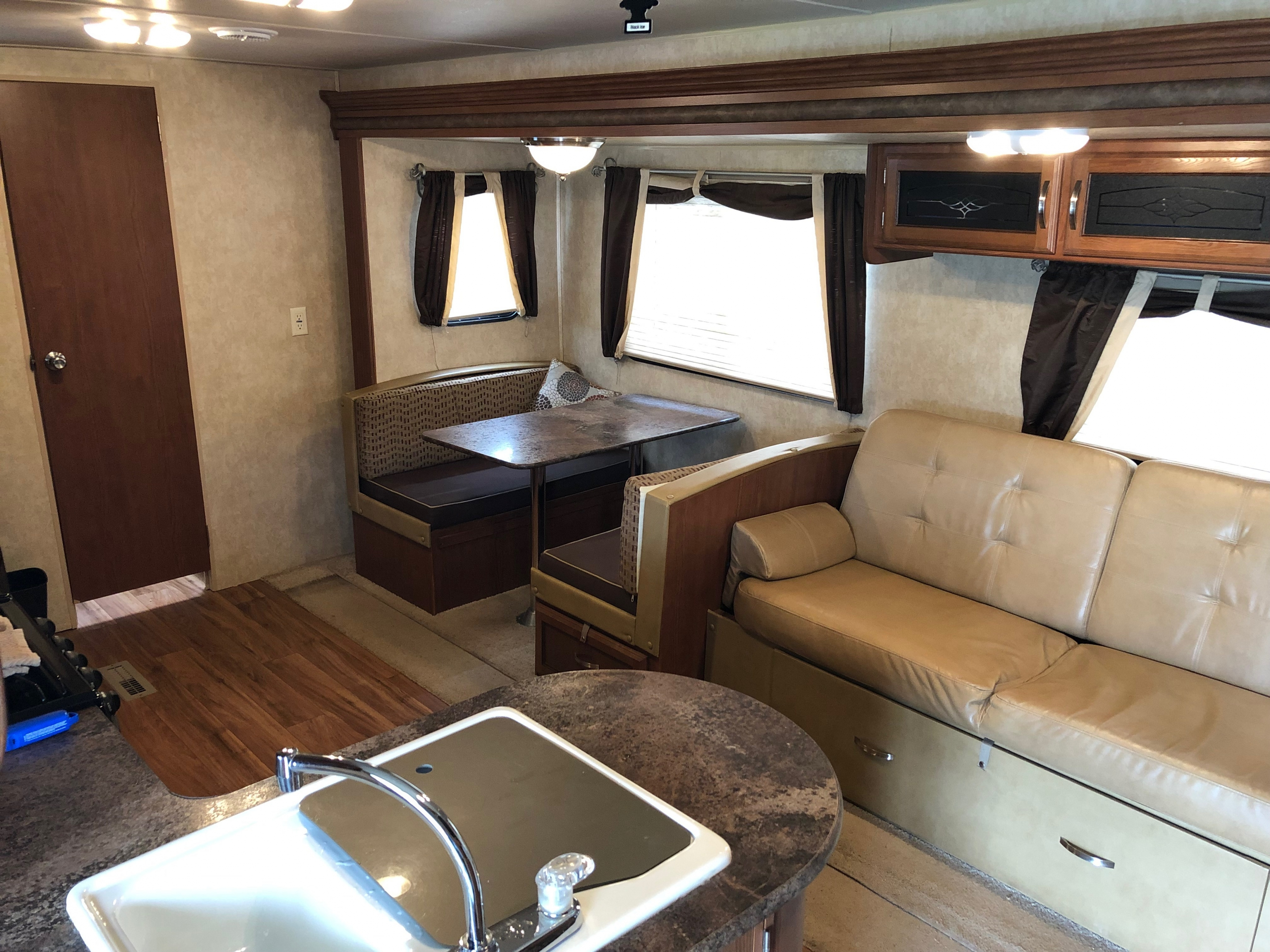 27' Wildwood Trailer with Slide Out Living Room, Kitchen, & Dinette View