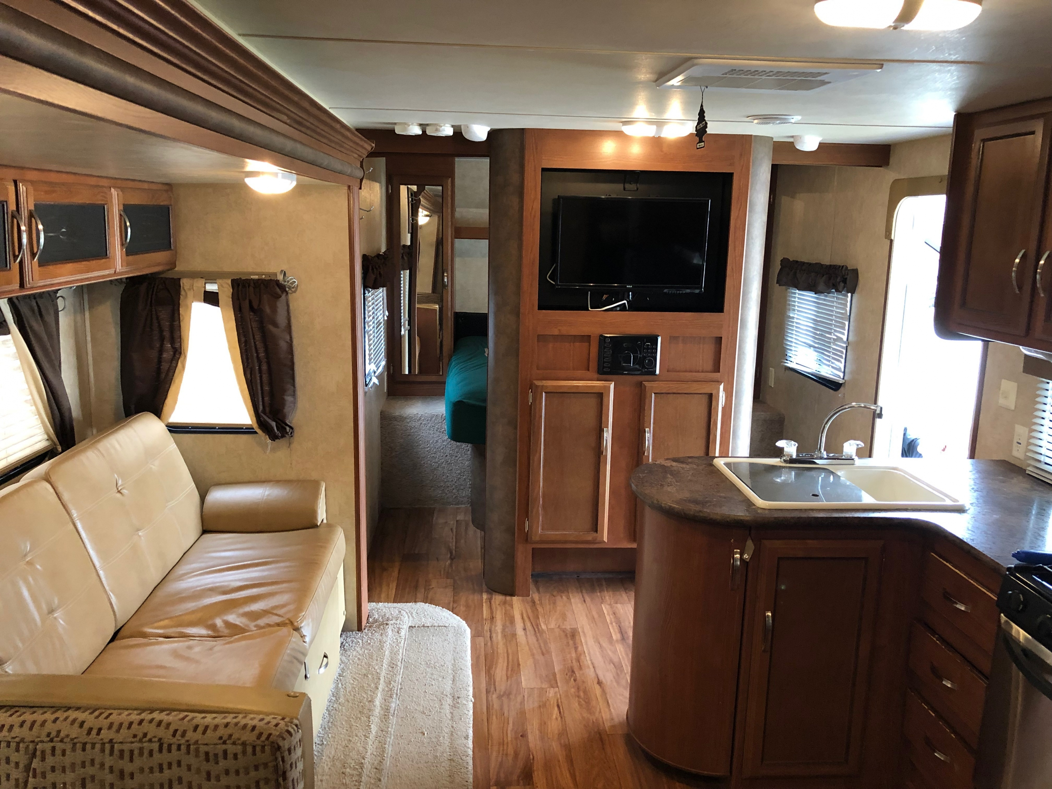 27' Wildwood Trailer with Slide Out Kitchen, Couch, & Forward View