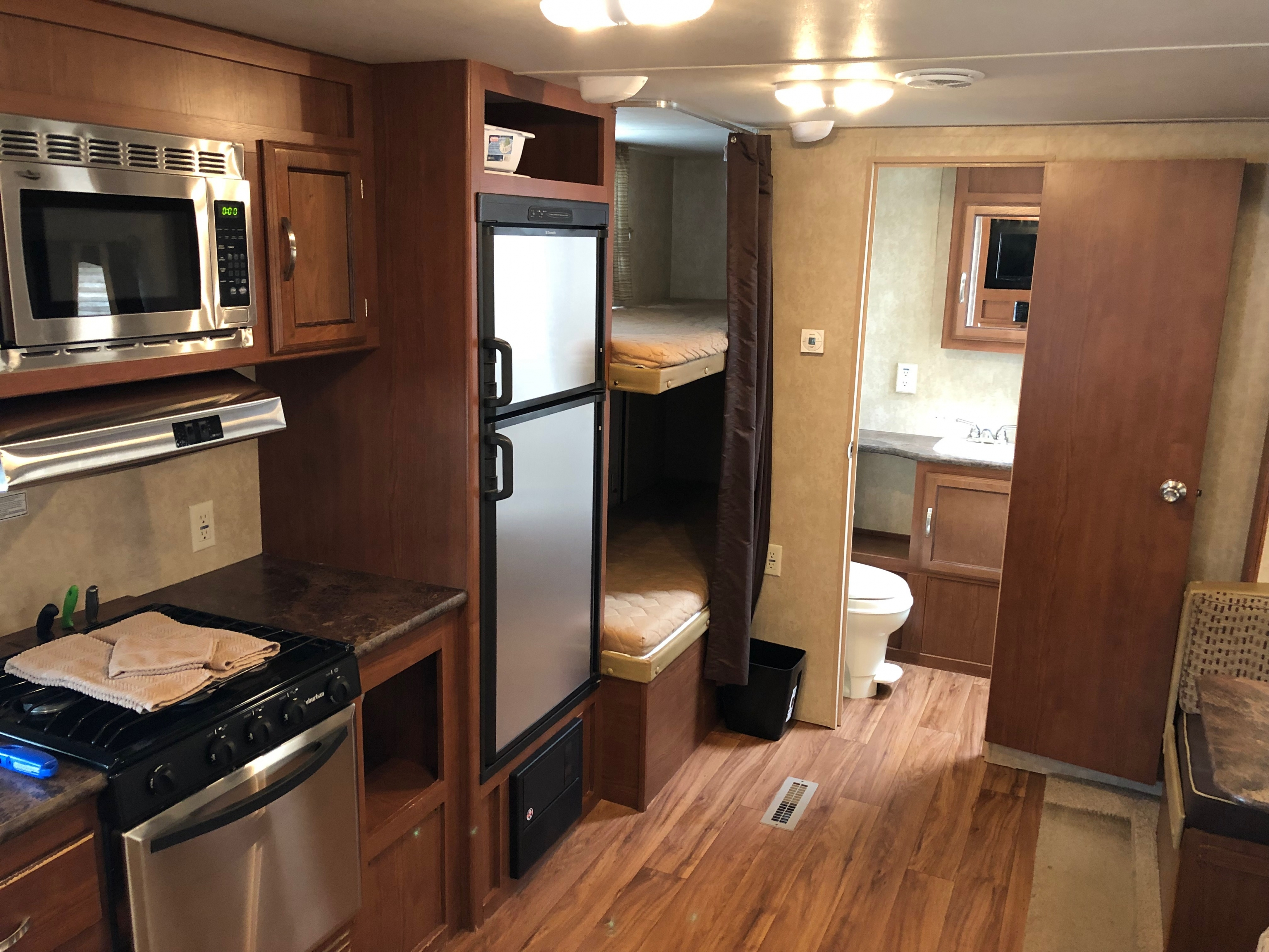 27' Wildwood Trailer with Slide Out Kitchen, Bunk Beds, & Rear View