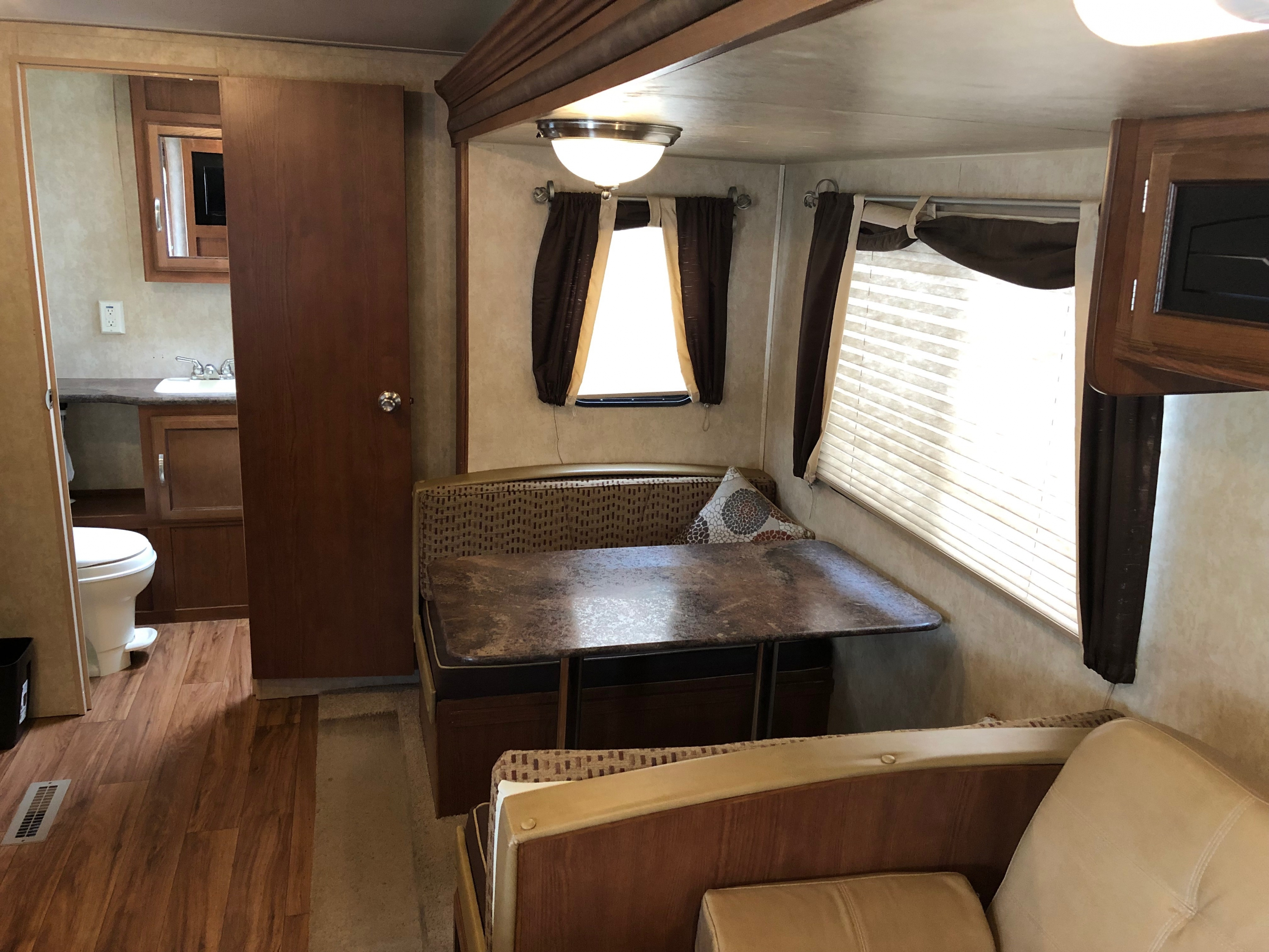 27' Wildwood Trailer with Slide Out Bathroom & Dinette View